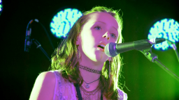 young musician singing into microphone