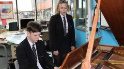Charlotte and Finlay at a piano