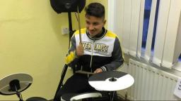 Filip playing the drums