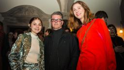 Maisie Murray (left) with her dad, and Brighter Sound music leader Lucy Wallace (right)