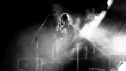 Black and white photo of musician on stage