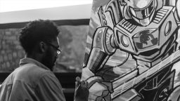 Young artist painting a piece of art - black and white photo