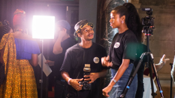Two young people with camera equipment talking