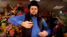 Man in a bowler hat and waistcoat in a flower shop
