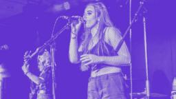 young person performing on stage, purple colour overlay