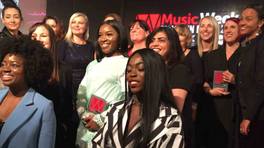 Group of women on stage in front of Music Week logo