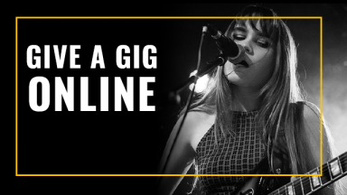 black and white photo of a girl playing a guitar singing into a microphone with text